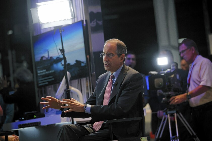 Brian Roberts, Comcast chairman and CEO, flew home from the Olympics to finalize the deal.