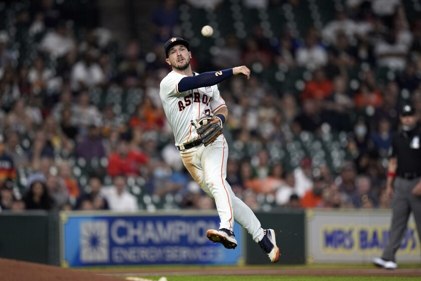 Houston Astros third baseman Alex Bregman throws to first for the out after fielding a ground ball by Boston Red Sox's Enrique Hernandez during the second inning of a baseball game Wednesday, June 2, 2021, in Houston. (AP Photo/David J. Phillip)