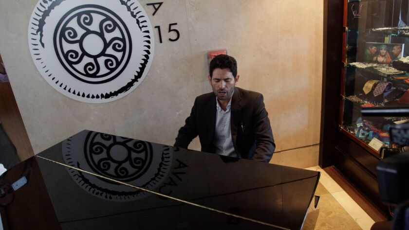 Orestes Fintiklis, manager of private equity fund Ithaca Capital, plays a piano at the Trump Ocean Club International Hotel and Tower in Panama City on Monday.