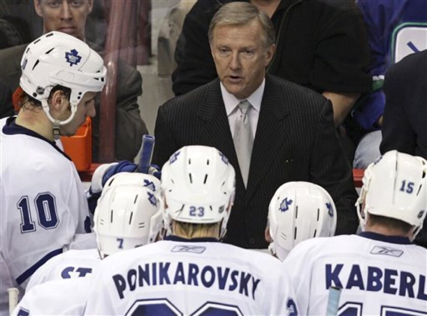 FILE - In this Nov. 15, 2008, file photo, Toronto Maple Leafs coach Ron Wilson speaks with his players after calling a timeout during an NHL hockey game against the Vancouver Canucks in Vancouver, British Columbia. The NHL fined the Maple Leafs an undisclosed amount after ruling that Wilson was guilty of tampering when he expressed interest in Vancouver Canucks forwards Henrik and Daniel Sedin before they reached free agency. NHL deputy commissioner Bill Daly announced the penalty Wednesday, Oct. 7, 2009, in a news release. (AP Photo/The Canadian Press, Darryl Dyck, File)