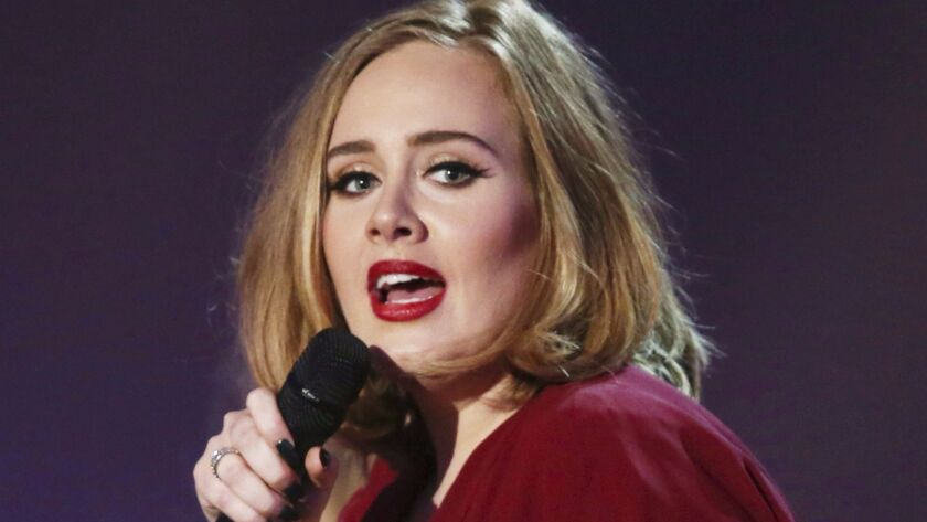 This Feb. 24, 2016 file photo shows Adele onstage at the Brit Awards 2016 in London. Adele is nominated for several Grammy Awards.