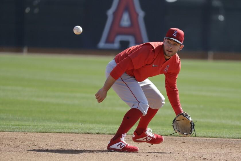 Angels' David Fletcher fields a ground ball during spring training baseball practice in Tempe, Ariz.