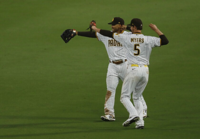 Trent Grisham and Wil Myers celebrate at the end of the Padres' win