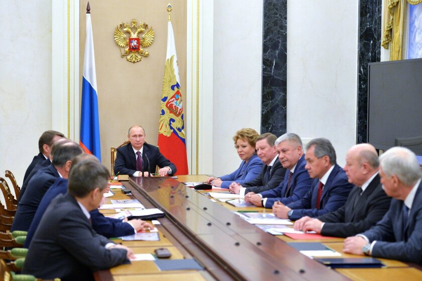 Russian President Vladimir Putin leads a Security Council meeting at the Kremlin in Moscow on Dec. 26, after which he signed into law a revised defense doctrine.
