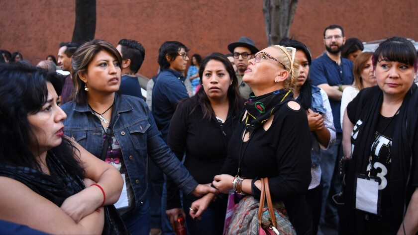 MEXICO CITY, MEXICO FEBRUARY 16, 2018-A scared crowd gathers outside the Holiday Inn along Insurgent