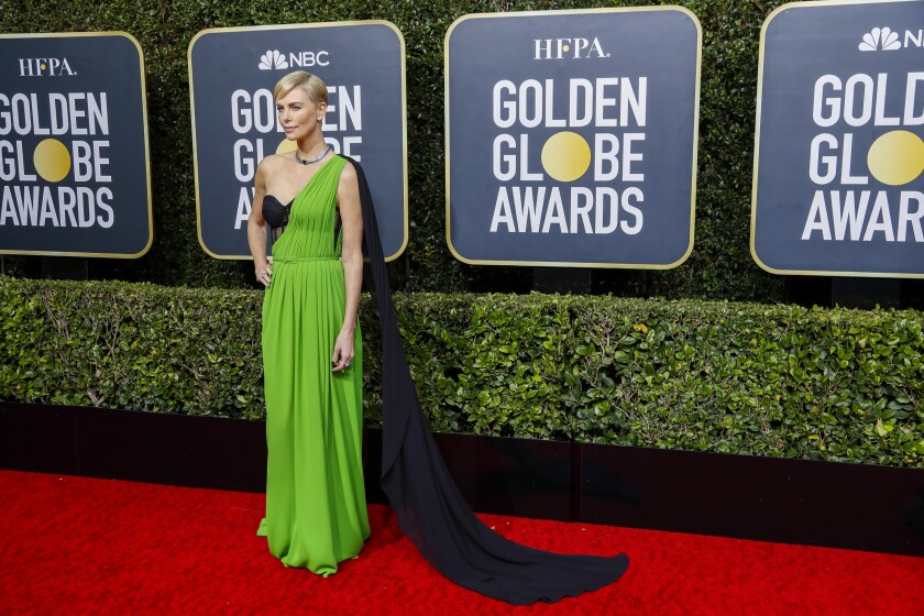 Charlize Theron arrives at the Golden Globes