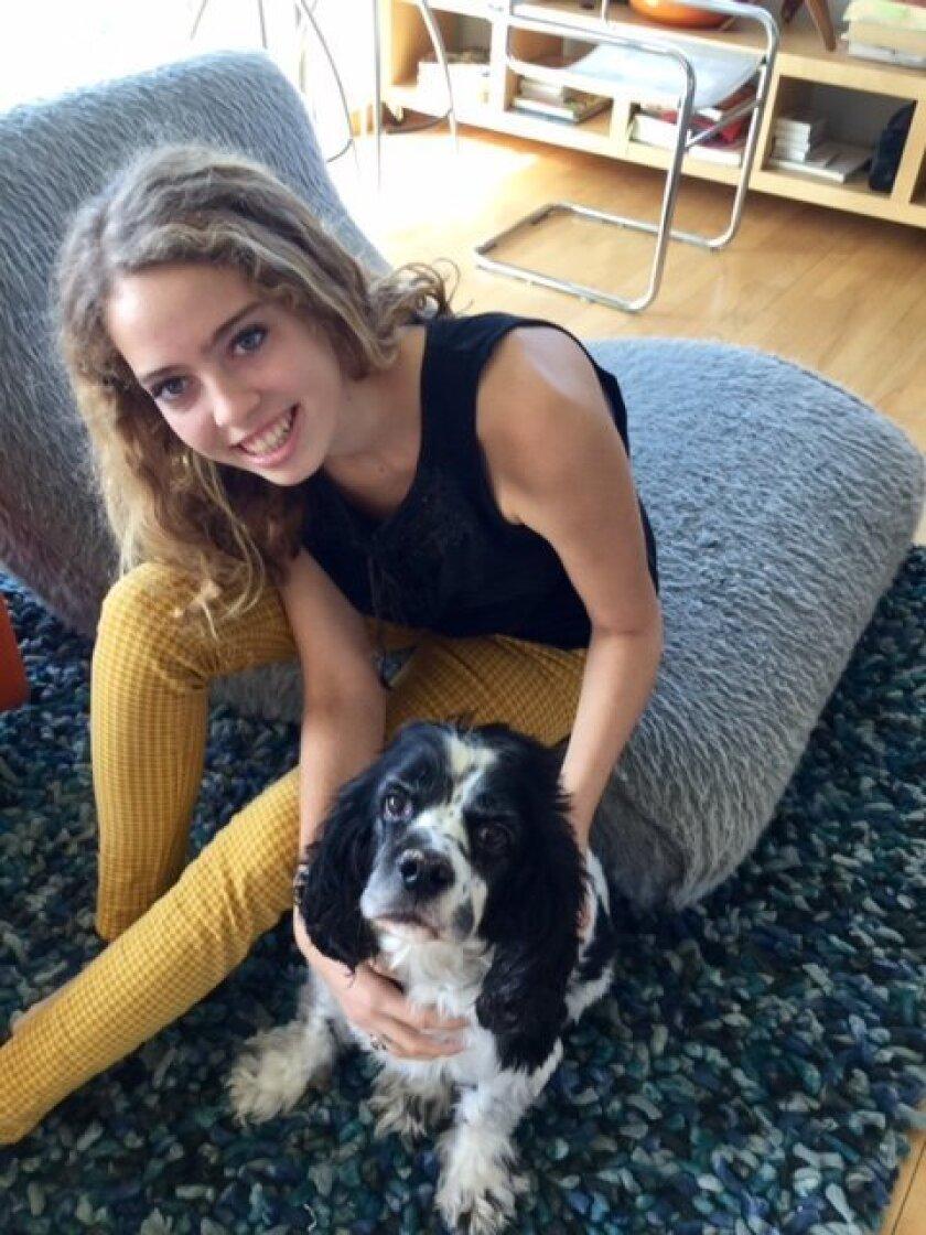 La Jolla High School student Ana Gimber with her dog, Paco. Courtesy