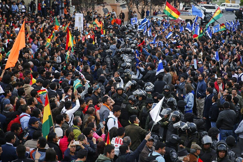 Rioting erupts as Bolivia announces Evo Morales is near an outright win
