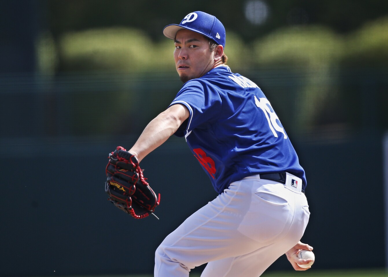 Los Angeles Dodgers pitcher Kenta Maeda pitches during a spring training baseball game against the Seattle Mariners Saturday, March 9, 2019, in Phoenix. (AP Photo/Sue Ogrocki)
