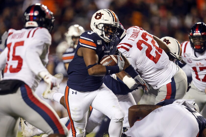 Auburn running back D.J. Williams (3) carries the ball during the first half of the team's NCAA college football game against Mississippi, Saturday, Nov. 2, 2019, in Auburn, Ala. (AP Photo/Butch Dill)