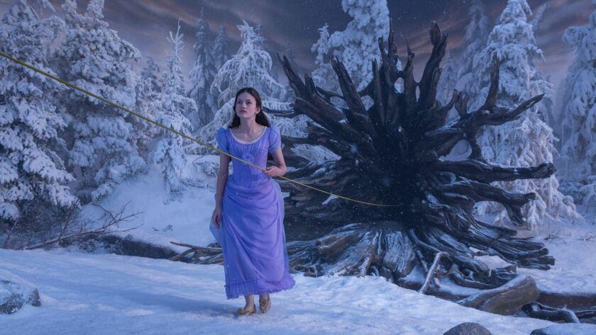 Mackenzie Foy is Clara in the ball dress.