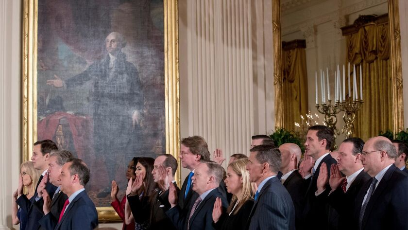 Advisors to President Trump swear an oath of service Sunday in the White House. In the front row are Kellyanne Conway, left, Jared Kushner, Stephen Bannon and Chief of Staff Reince Priebus.