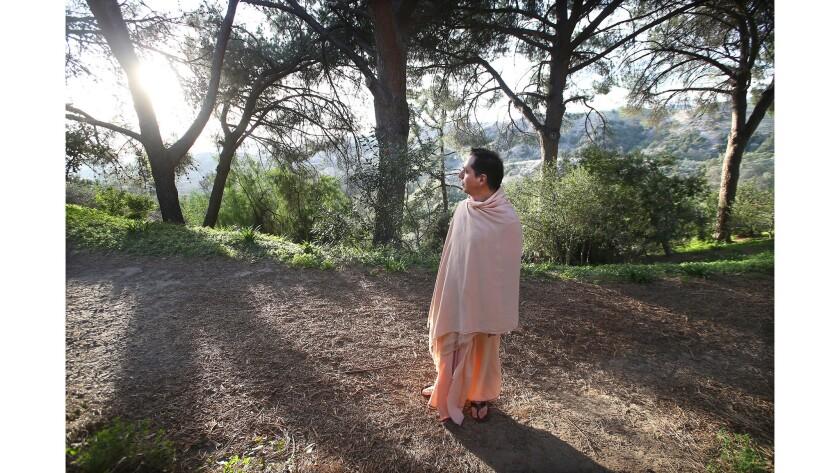 Swami Dhyanayogananda walks to view the sunset at the Ramakrishna Monastery in Trabuco Canyon.