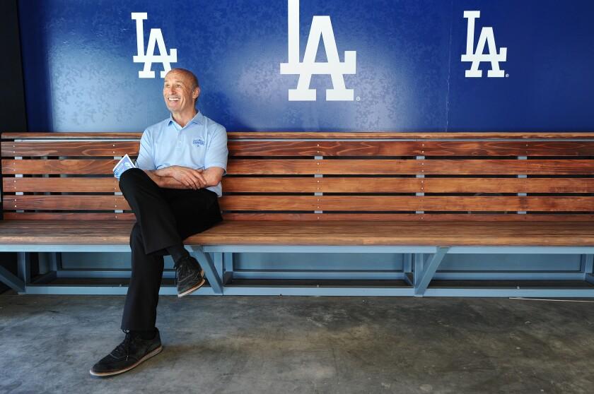 Dodgers president Stan Kasten sits under the center field bleachers