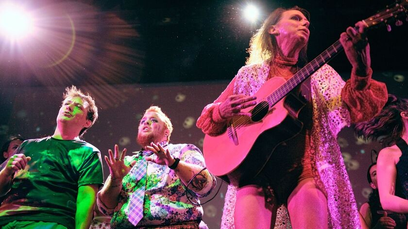 Lindsey Deaton, founder of the Trans Chorus of Los Angeles, performs with Rob Carrillo, left, and Er