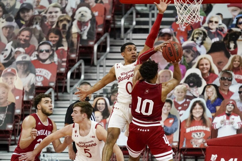 Indiana's Rob Phinisee tries to shoot with Wisconsin's D'Mitrik Trice defending during the first half of an NCAA college basketball game Thursday, Jan. 7, 2021, in Madison, Wis. (AP Photo/Morry Gash)