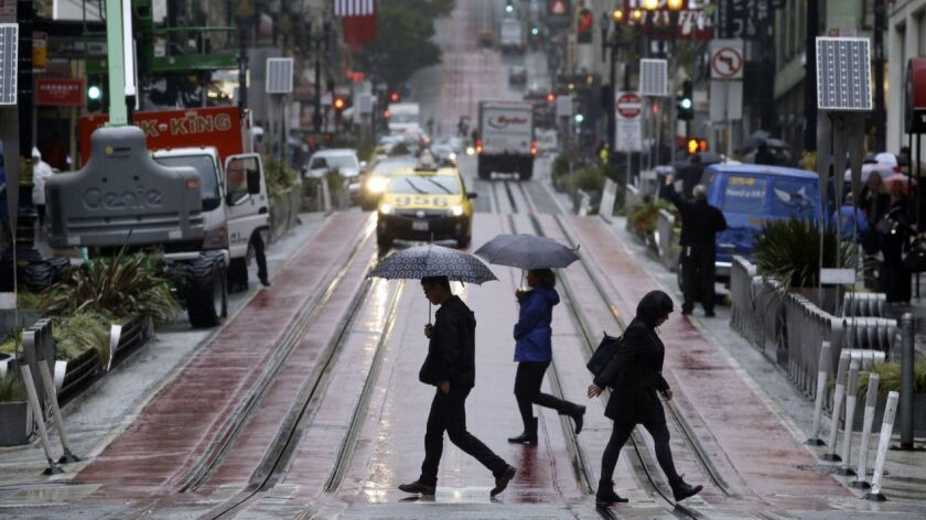 A storm that could drop as much rain on the Bay Area as the region typically receives in all of April is expected to soak the area before moving on to Southern California Saturday. Above, pedestrians cross Ellis Street on a rainy day in San Francisco in 2016.