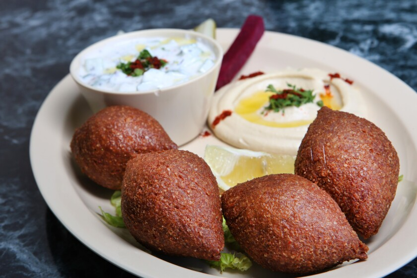 Fried kobee, hummus and yogurt with cucumber at the Kobee Factory & Syrian Kitchen