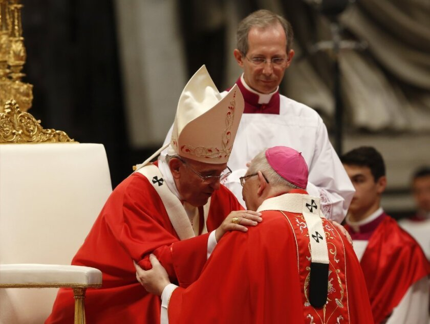 The same outfit: Pope Francis bestows a pallium on Archbishop Leonard Blair of Hartford, Conn., on June 29.