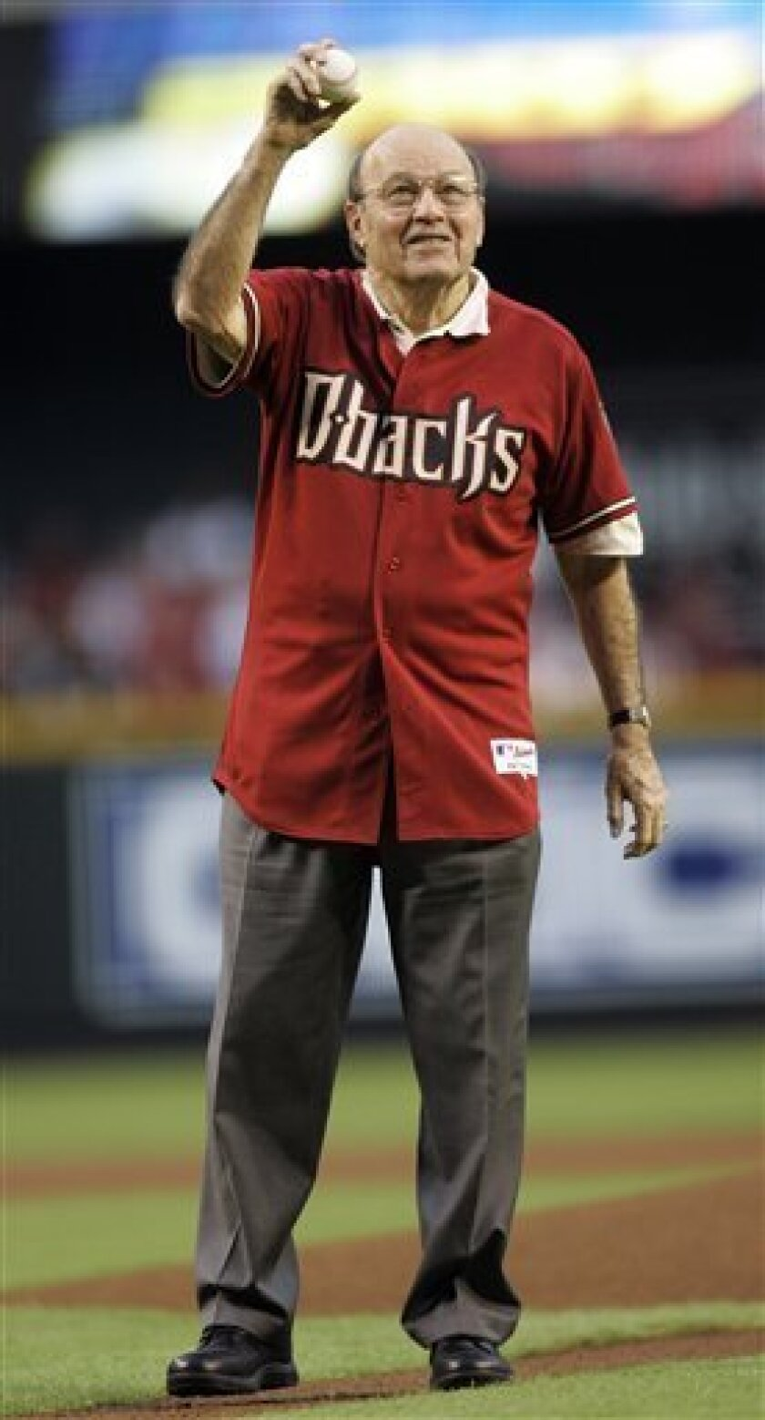 FILE - In this Oct. 11, 2007, file photo, Hall of Fame broadcaster Joe Garagiola throws out the ceremonial first pitch before Game 1 of the National League Championship baseball series between the Arizona Diamondbacks and Colorado Rockies in Phoenix. Garagiola, whose career transcended sports with
