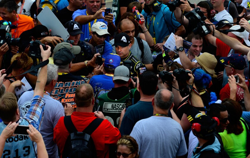 Jeff Gordon draws a crowd Saturday during practice for his final NASCAR Sprint Cup Series race.