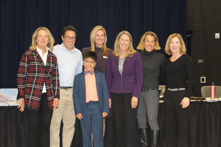 Aaron D'Souza, a Solana Ranch fourth grader, with the Solana Beach School District superintendent and board members.