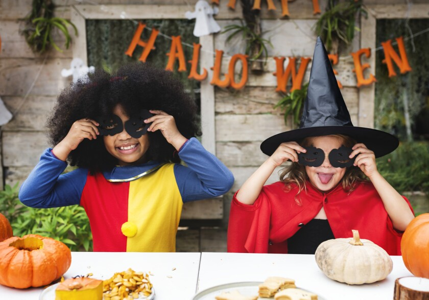 Kids in costume enjoying the Halloween season.