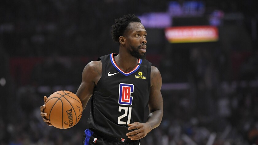 Clippers guard Patrick Beverley dribbles during the second half against the Denver Nuggets on Feb. 28 at Staples Center.