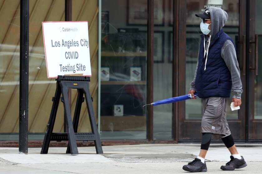 A person arrives at Carbon Health, a coronavirus testing site in Echo Park, on Wednesday. The site offers walk-up testing, which will be available at Kedren Community Health Center in South Los Angeles beginning Tuesday.