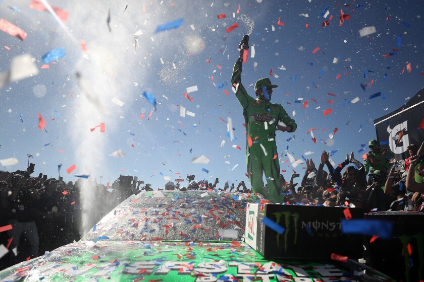 Kyle Busch celebrates in victory lane after winning the Auto Club 400 for his 200th NASCAR win March 17 in Fontana.