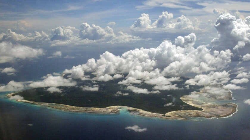 FILE – In this Nov. 14, 2005 file photo, clouds hang over the North Sentinel Island, in India's sout