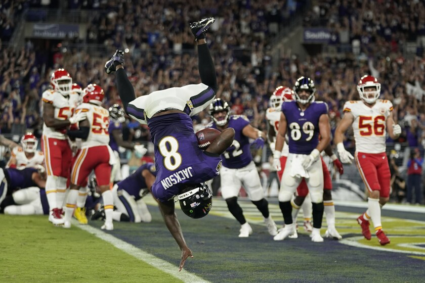 Baltimore Ravens quarterback Lamar Jackson scores a touchdown in the second half of an NFL football game against the Kansas City Chiefs, Sunday, Sept. 19, 2021, in Baltimore. (AP Photo/Julio Cortez)
