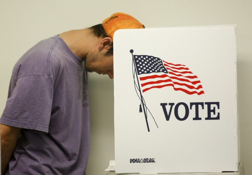 A voter casts a ballot in Norwalk in 2016.