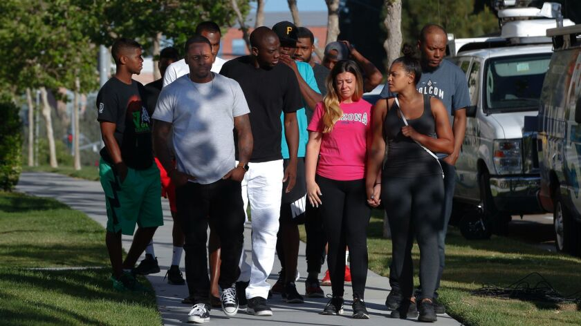 Walking to their press conference, victims who were at the shooting last Sunday at the La Jolla Cros