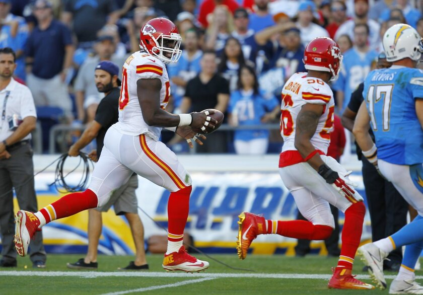 Chiefs Justin Houston returns an interception for a touchdown in the 3rd quarter against the Chargers.