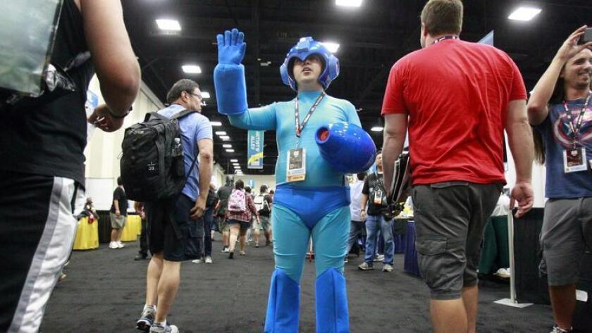 A costumed Daniel Villasenor asks the very first conventioneers entering the exhibit hall to not run during Comic-Con's Preview Night at the San Diego Convention Center in San Diego on Wednesday. (Hayne Palmour IV)