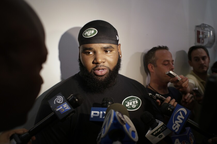 New York Jets defensive end Sheldon Richardson responds to questions during an interview Thursday at training camp.