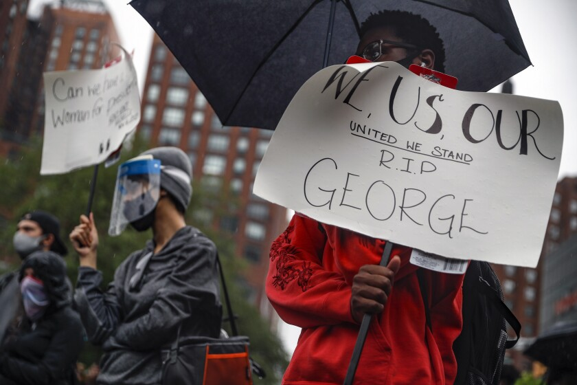 Protesters gather in the rain for a rally at Union Square, Friday, June 5, 2020, in the Manhattan borough of New York. Protests continued following the death of George Floyd, who died after being restrained by Minneapolis police officers on May 25. (AP Photo/John Minchillo)