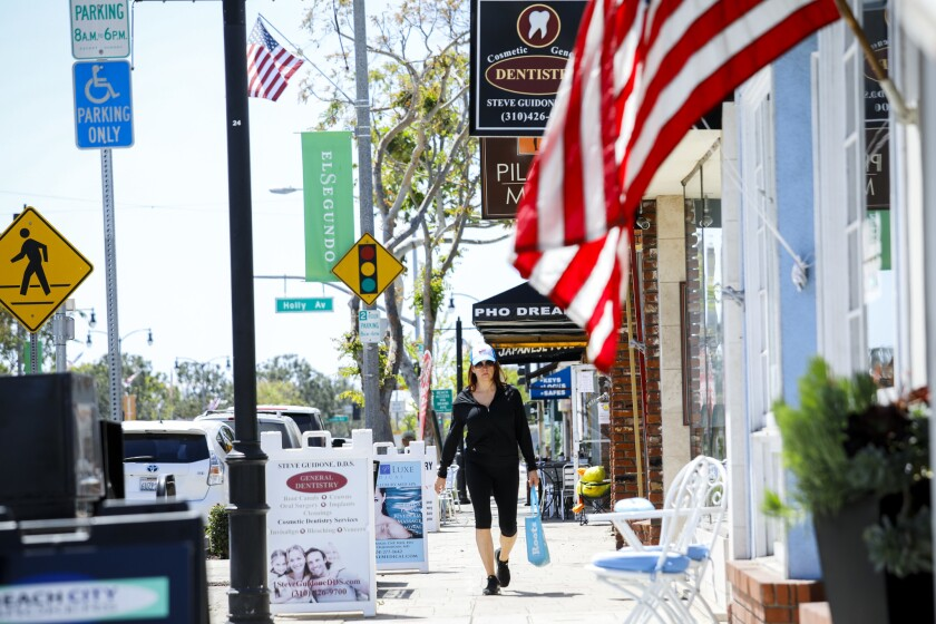 "Main Street is strewn with American flags in El Segundo, a seaside secret where its ""small-town Mayberry kind of thing"" is treasured, one resident says."