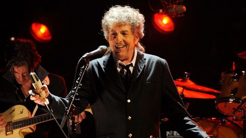 FILE - In this Jan. 12, 2012, file photo, Bob Dylan performs in Los Angeles. The Swedish Academy say