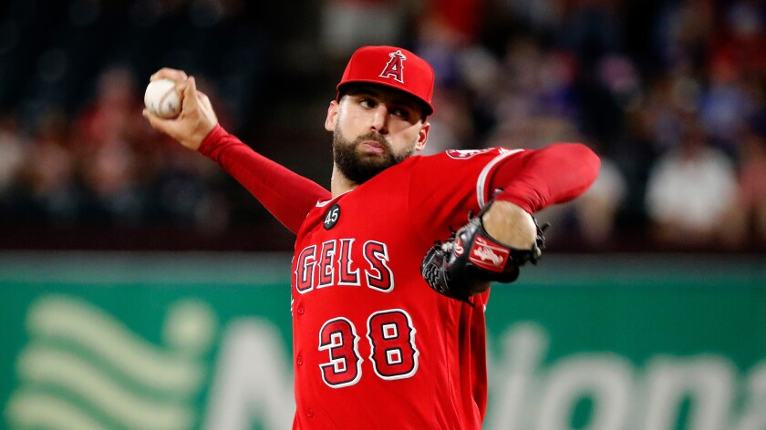 Angels relief pitcher Justin Anderson throws to the Texas Rangers.