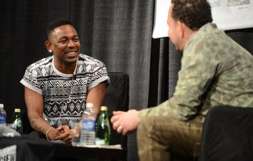 Rapper Kendrick Lamar, left, in conversation with Jessie Wright at the 2013 South by Southwest festival in Austin, Texas. Lamar appeared in an official showcase at Austin Music Hall on Friday.