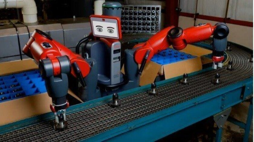 Baxter, a robot designed By Rethink Robotics to perform simple assembly-line tasks, demonstrates its capabilities.