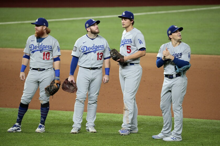 Dodgers infielders meet near the mound during a pitching change.