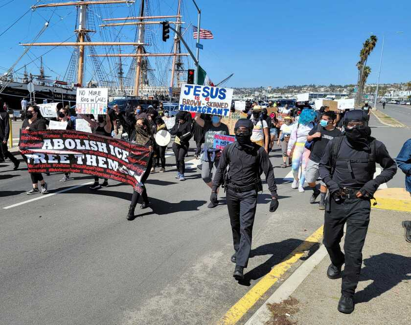 Protestors march through downtown San Diego on Saturday calling for the abolishment of ICE