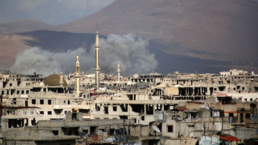 Bombardment in the rebel-held neighborhood of Jobar, on the eastern edge of the Syrian capital of Damascus.