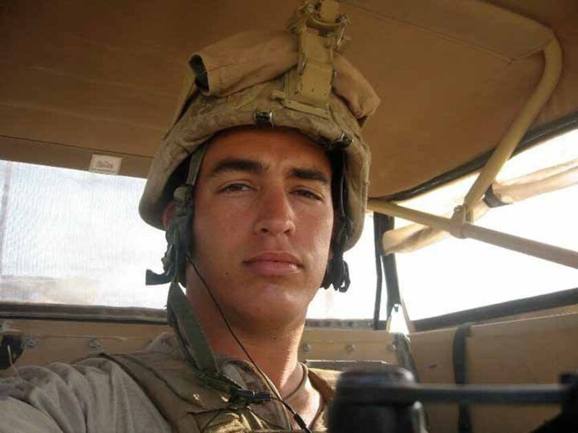 Sgt. Andrew Tahmooressi looks down from his seat in a Marine combat vehicle during one of his combat tours in Afghanistan. Tahmooressi is now in a Tijuana prison on weapons charges.