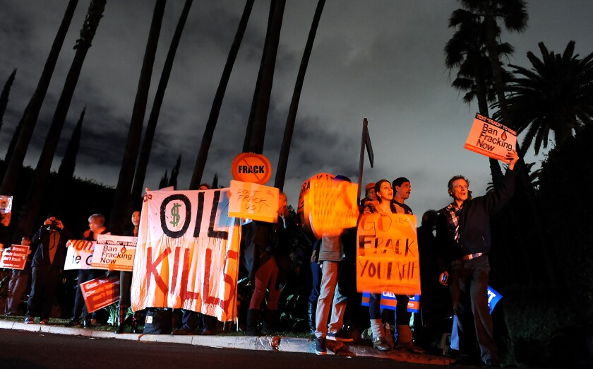 Environmentalists protest outside a home in Bel-Air where Gov. Jerry Brown attended a fundraiser last November. The protestors were calling for a ban on fracking.