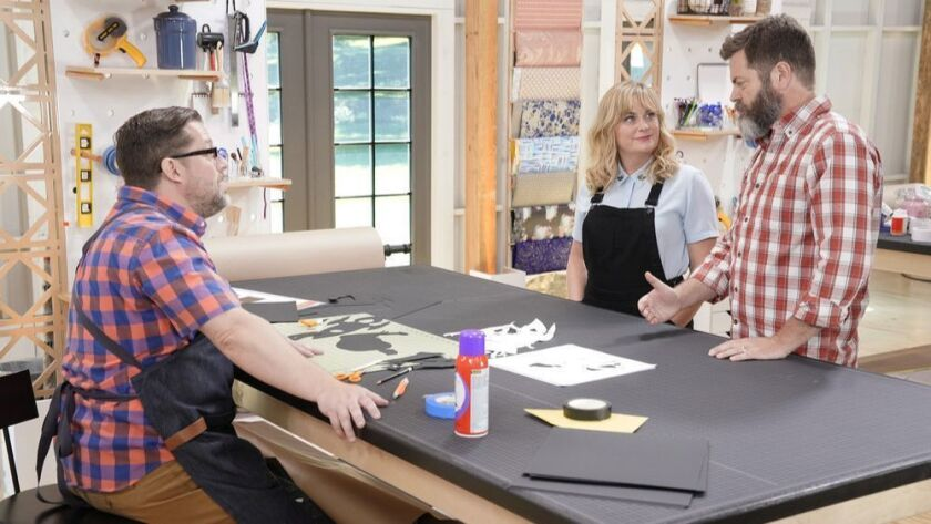 """Maker Robert Mahar, left, with hosts Amy Poehler and Nick Offerman in the opening episode of the NBC crafts-based competition series """"Making It."""""""