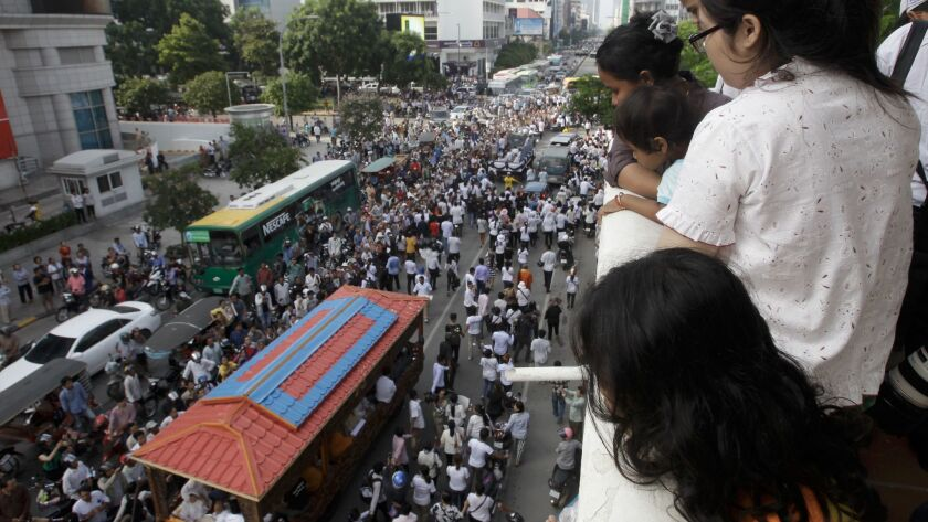 Tens of thousands marched in the funeral procession for Kem Ley in Phnom Penh, Cambodia, on July 24, 2016. Ley, 45, was fatally shot in an attack that raised suspicion of a political conspiracy.